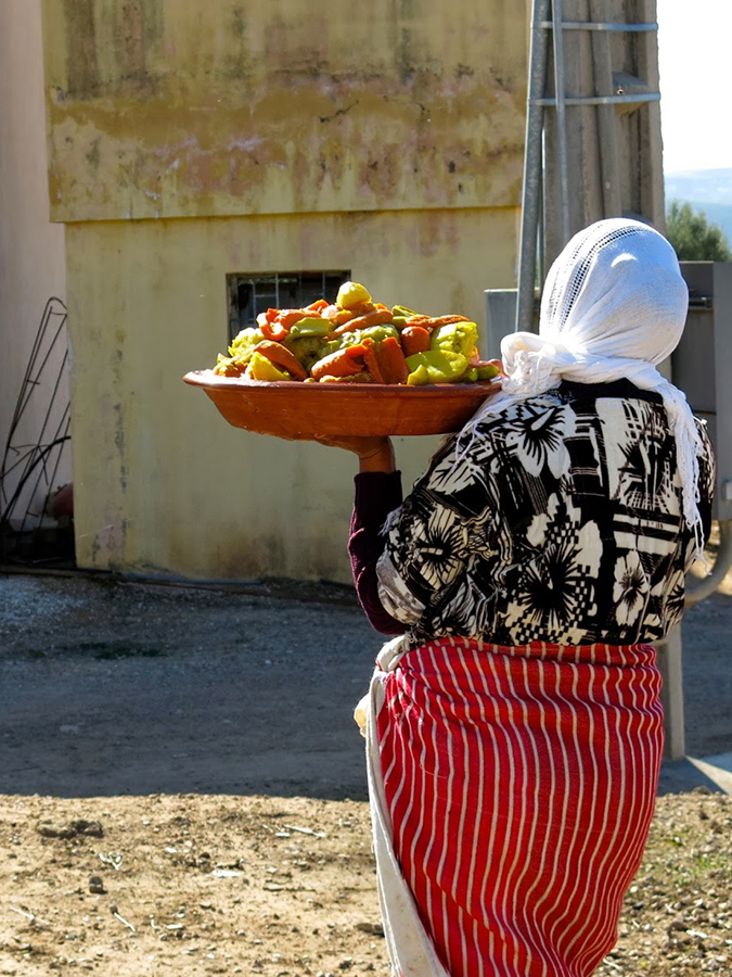 ISA Morocco woman carries food